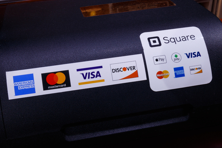 Indianapolis - Circa May 2018: Modern mobile credit methods including Square, Apple Pay, Android Pay, Visa, Master Card, American Express and Discover III