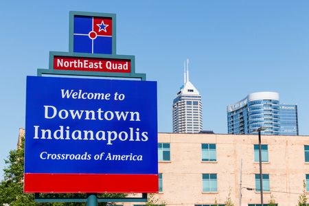 Indianapolis - Circa May 2018: Sign welcoming you to Downtown Indianapolis with the Salesforce Tower, Regions Bank building and 360 Market Square I Editorial