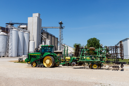 Kokomo - Circa May 2018: John Deere 8400T tractor and 726 Soil Finisher. Deere manufactures agricultural, construction, and forestry machinery III Editorial