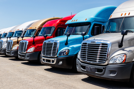 Indianapolis - Circa June 2018: Colorful Freightliner Semi Tractor Trailer Trucks Lined up for Sale. Freightliner is owned by Daimler AG Trucks I