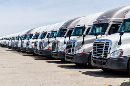 Indianapolis - Circa June 2018: Freightliner Semi Tractor Trailer Trucks Lined up for Sale. Freightliner is owned by Daimler AG Trucks III Editorial