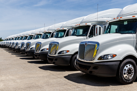 Indianapolis - Circa June 2018: International Semi Tractor Trailer Trucks Lined up for Sale. International is owned by Navistar I