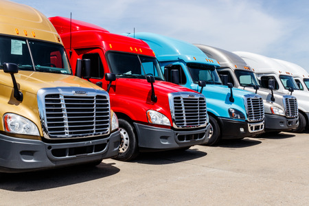 Indianapolis - Circa June 2018: Colorful Freightliner Semi Tractor Trailer Trucks Lined up for Sale. Freightliner is owned by Daimler AG Trucks IV Editorial