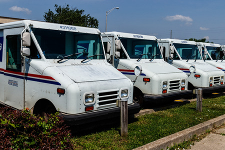 Logansport - Circa June 2018: USPS Post Office Mail Trucks. The Post Office is Responsible for Providing Mail Delivery V
