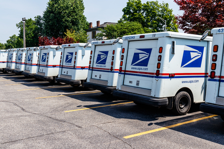 Logansport - Circa June 2018: USPS Post Office Mail Trucks. The Post Office is Responsible for Providing Mail Delivery IV