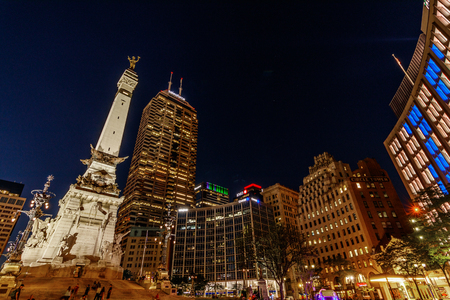 Indianapolis - Circa July 2018: Colorful downtown Indianapolis skyline at the circle with the monument, Salesforce, BMO Harris, Chase, Regions and IPL towers I Editöryel