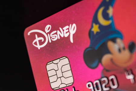 Indianapolis - Circa July 2018: Disney logo on a credit card. Disney is wrapping up the purchase of 21st Century Fox IV