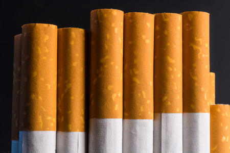 Close up pack of filtered cigarettes. Quitting smoking is the single easiest way to avoid heart disease Stock Photo