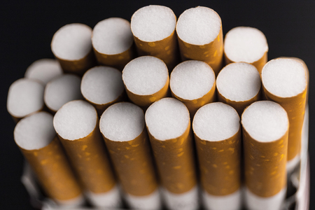Close up pack of filtered cigarettes. Quitting smoking is the single easiest way to avoid heart disease II Stock Photo