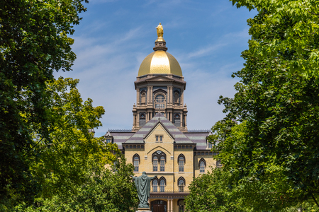 Notre Dame - Circa August 2018: Mary stands atop the Golden Dome of the University of Notre Dame Main Administration Building IV Editorial
