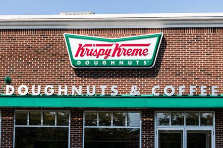 Mishawaka - Circa August 2018: Krispy Kreme Signage and Logo. Krispy Kreme has a loyal following for their doughnuts I