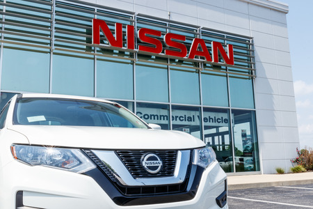 Fishers - Circa August 2018: New vehicles at a Nissan Car and SUV Dealership. Nissan is part of the Renault–Nissan Alliance VII 報道画像