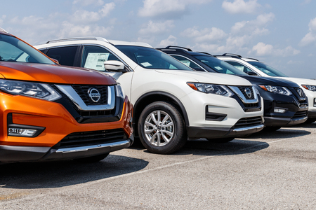 Fishers - Circa August 2018: New vehicles at a Nissan Car and SUV Dealership. Nissan is part of the Renault–Nissan Alliance VIII Editorial