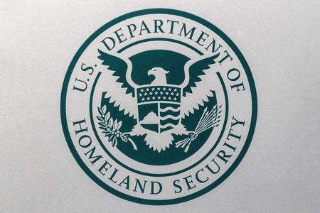 Indianapolis - Circa August 2018: Logo and seal of the United States Department of Homeland Security. DHS runs Immigration and Customs Enforcement (ICE) I