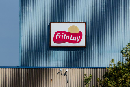 Frankfort - Circa August 2018: Frito-Lay snack food plant. Frito-Lay is a subsidiary of PepsiCo that manufactures chips and other salty foods III Editorial