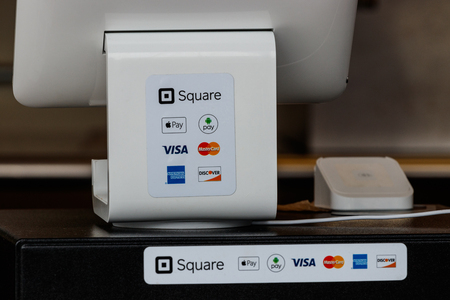 Indianapolis - Circa September 2018: Modern mobile credit methods including Square, Apple Pay, Android Pay, Visa, Master Card, American Express and Discover V