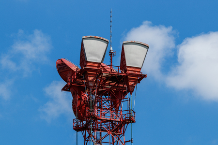 Microwave receive and transmission tower with wireless signal for telecommunications Stock Photo