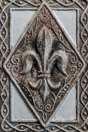 Antique Fleur-de-lis on Tile I Stock Photo
