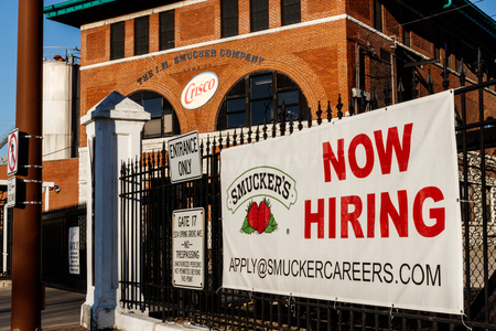 Cincinnati - Circa February 2019: Now Hiring sign at J. M. Smucker Company. Smucker manufactures jams, jellies and a variety of food items I