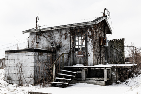 Abandoned snow covered electrical shack - Worn, Broken and Forgotten I