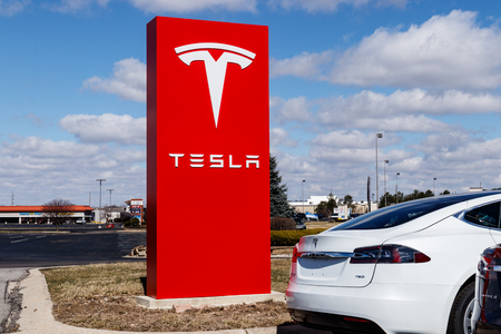 Indianapolis - Circa March 2019: Tesla Service Center. Tesla says new V3 Supercharger stations will reduce recharging times by half I
