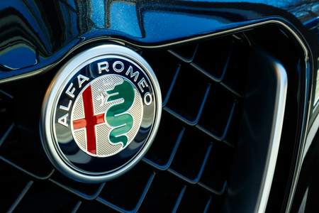Indianapolis - Circa March 2019: Logo of Alfa Romeo, a division of FCA. The logo shows a red cross, from the emblem of Milan, and the biscione, a crowned viper swallowing a Moor I Editorial