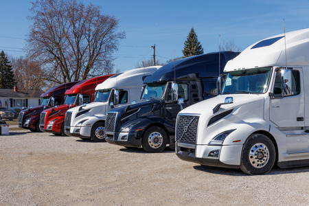 Muncie - Circa March 2019: Colorful Volvo Semi Tractor Trailer Trucks Lined up for Sale. Volvo is one of the largest truck manufacturers III