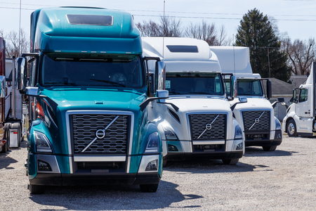 Muncie - Circa March 2019: Colorful Volvo Semi Tractor Trailer Trucks Lined up for Sale. Volvo is one of the largest truck manufacturers IV