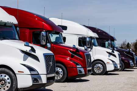 Muncie - Circa March 2019: Colorful Volvo Semi Tractor Trailer Trucks Lined up for Sale. Volvo is one of the largest truck manufacturers II