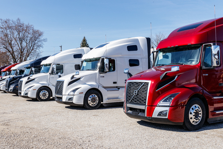 Muncie - Circa March 2019: Colorful Volvo Semi Tractor Trailer Trucks Lined up for Sale. Volvo is one of the largest truck manufacturers V
