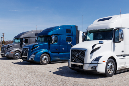 Muncie - Circa March 2019: Colorful Volvo Semi Tractor Trailer Trucks Lined up for Sale. Volvo is one of the largest truck manufacturers I