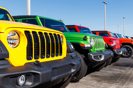 Noblesville - Circa April 2019: Jeep Wranglers on display at a Chrysler Jeep dealership. The subsidiaries of FCA are Chrysler, Dodge, Jeep, and Ram II