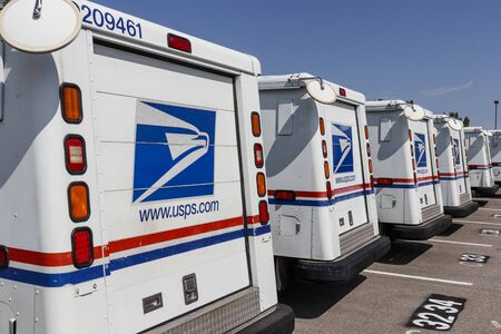 Indianapolis - Circa August 2019: USPS Post Office Mail Trucks. The Post Office is responsible for providing mail delivery VIII Editorial