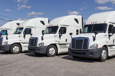 Ft. Wayne - Circa August 2019: Freightliner Semi Tractor Trailer Trucks Lined up for Sale VII