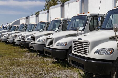 Zionsville - Circa August 2019: Freightliner Semi Tractor Trailer Trucks Lined up for Sale. Freightliner is owned by Daimler Trucks I