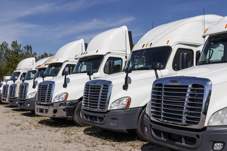 Zionsville - Circa August 2019: Freightliner Semi Tractor Trailer Trucks Lined up for Sale. Freightliner is owned by Daimler Trucks III