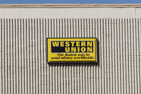 Kokomo - Circa September 2019: Western Union signage and logo. Western Union sent telegrams over telegraph and now offers wire transfers, money orders and money transfers