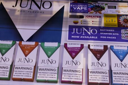 Indianapolis - Circa January 2020: Juno Vapor e-cigarette display. While e-cigarettes help people quit smoking, officials are alarmed at the skyrocketing use by teenagers, children and adolescents