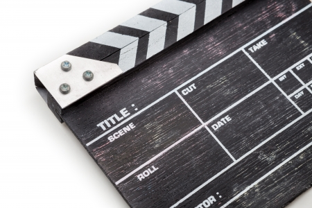 wooden clapper board isolated on white background photo