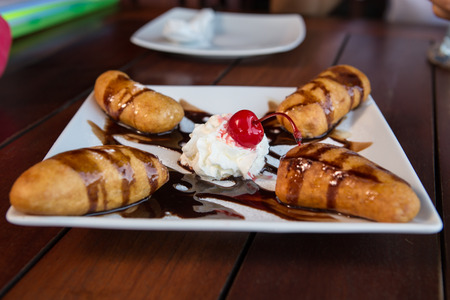 fritter: banana fritter with  whipcream and chocolate sauce