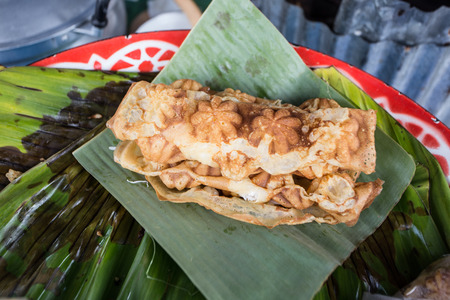 shredded coconut: Kha Nom Dok Don Thai crispy pancake shredded coconut inside Kind of sweetmeat famous in southern of Thailand Stock Photo