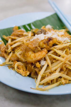 char: stir-fried ricecake strips Char Kway Teow popular dish in Malaysia, Indonesia, Brunei and Singapore