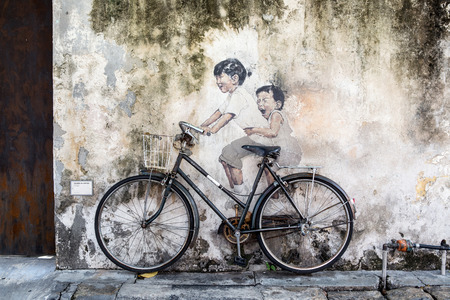 sidewall: PENANG, MALAYSIA - APRIL 14: on April 15, 2015: street art name Kids on Bicycle in George Town Penang, Malaysia, April 14,2015 ;walking or biking around Goerge town to discover Street Arts is one of dont miss activity in George Town,Penang,Malaysia.
