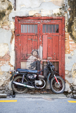 PENANG, MALAYSIA - APRIL 14: on April 15, 2015: street art name Old Motorcycle in George Town Penang, Malaysia, April 14,2015 ;walking or biking around Goerge town to discover Street Arts is one of don't miss activity in George Town,Penang,Malaysia.