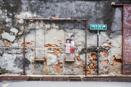 sidewall: PENANG, MALAYSIA - APRIL 14: on April 15, 2015: street art name Children on the swing in George Town Penang, Malaysia, April 14,2015 ;walking or biking around Goerge town to discover Street Arts is one of dont miss activity in George Town,Penang,Malays