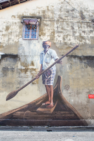 sidewall: PENANG, MALAYSIA - APRIL 14: on April 15, 2015: street art name fisherman on boat in George Town Penang, Malaysia, April 14,2015 ;walking or biking around Goerge town to discover Street Arts is one of dont miss activity in George Town,Penang,Malaysia. Editorial
