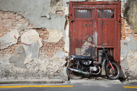 sidewall: PENANG, MALAYSIA - APRIL 14: on April 15, 2015: street art name Old Motorcycle in George Town Penang, Malaysia, April 14,2015 ;walking or biking around Goerge town to discover Street Arts is one of dont miss activity in George Town,Penang,Malaysia.