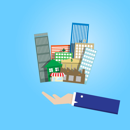 immovable property: business man hand holding group of real estate building