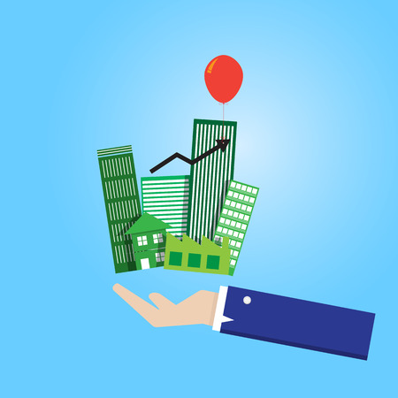 bulding: business man hand hold group of building property with floating arrow graph by balloon