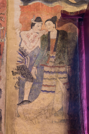 pu: NAN,THAILAND July 29: Thailand's famous ancient wall murals called Pu Man, Ya Man which appears on the wall paintings, in Tai Lue style on July 29,2015. Nan,Thailand.